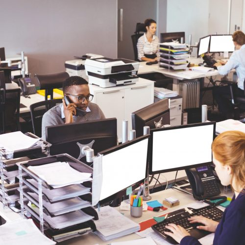 High angle view of business people working at desk in office